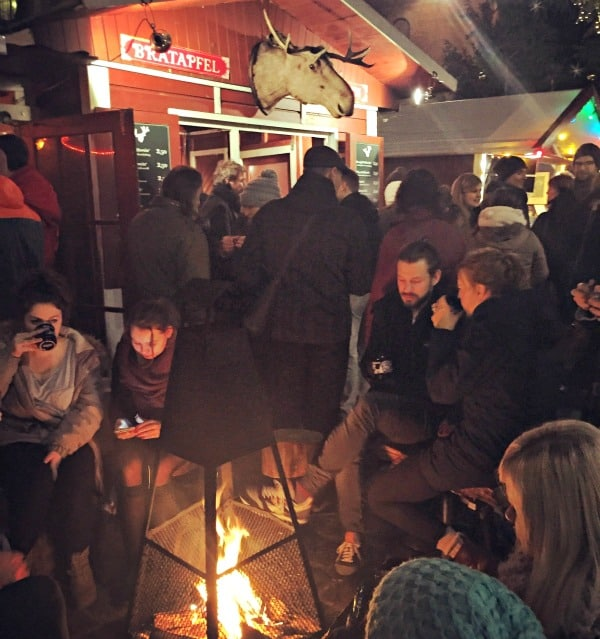 Gathered around a fire at Lucia Christmas market