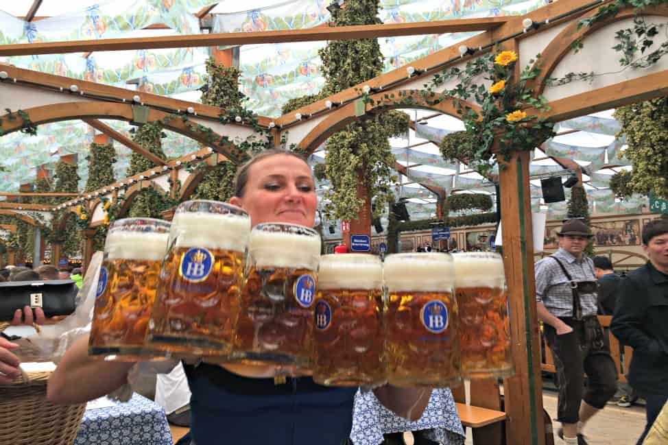 Oktoberfest beer maid carrying steins