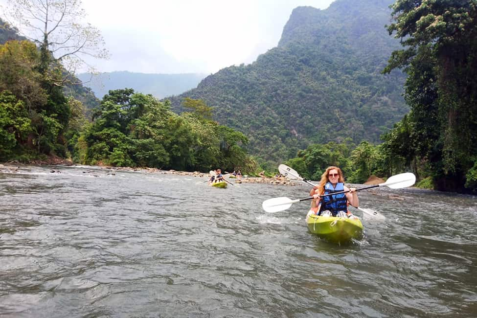 Kayaking down the river in Vang Vieng