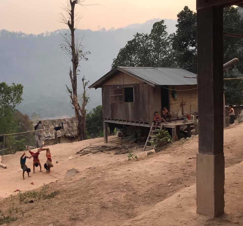 Children playing at a village in Laos