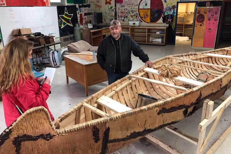 Billy Joe shows one of his canoes in progress