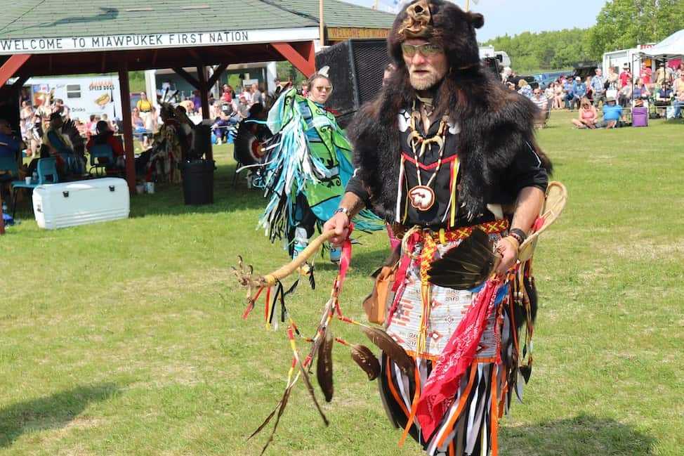 a man at the Conne River Pow Wow in a bear suit