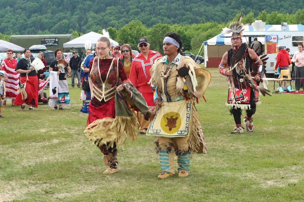 dancers in colourful regalia at the Conne River Pow Wow