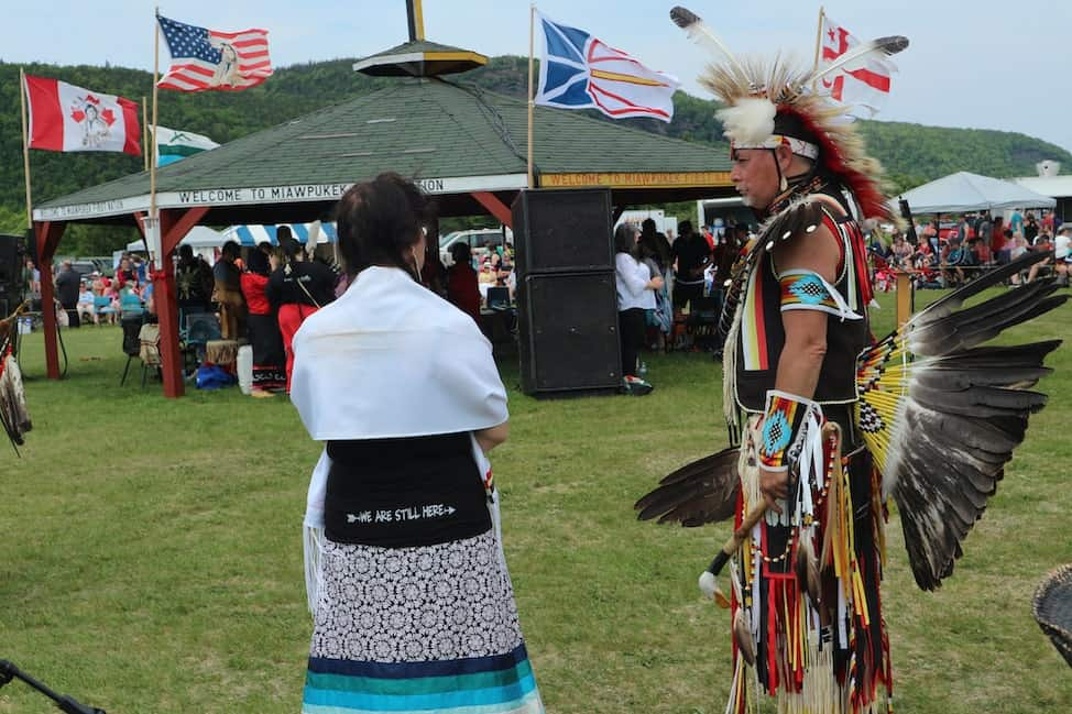 a woman talks with a warrior chief at the Conne River Pow Wow