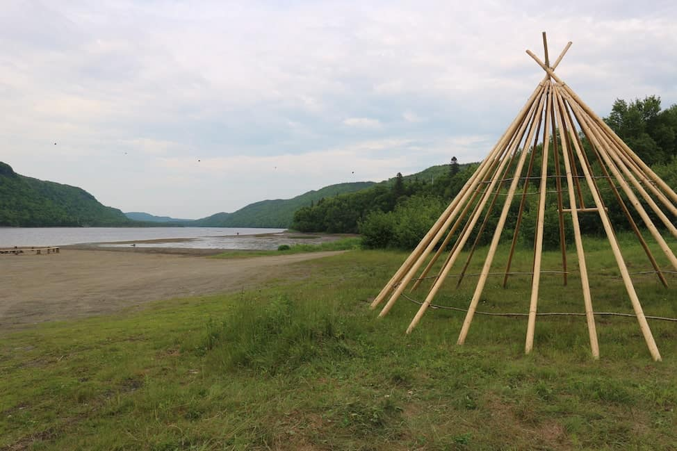 a wigwam without its coverings along the water in Conne River